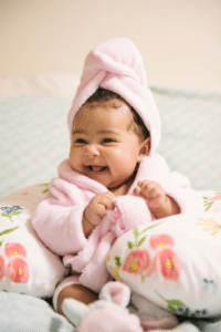 Happy baby in a towel